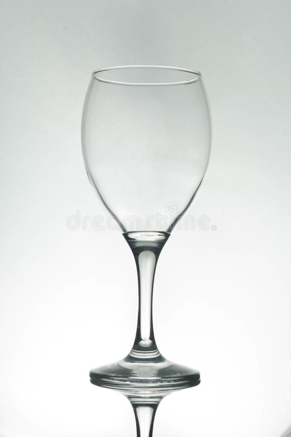 Empty wine glass silhouette, white background royalty free stock images