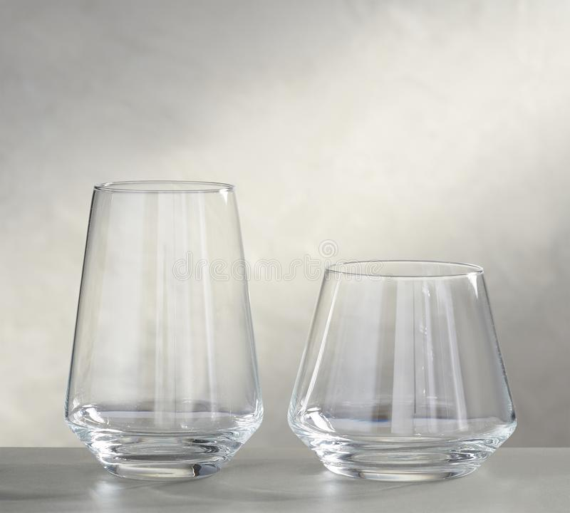 Empty wine glasses on the glass table and white background stock photo