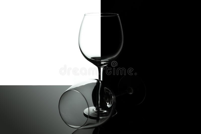 Empty wine glasses for wine isolated on black and white background. Wine list design menu with copy space. Alcohol royalty free stock photos