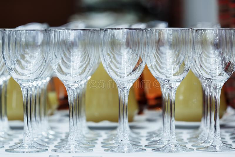 Empty wine glasses on stand on the table royalty free stock photography