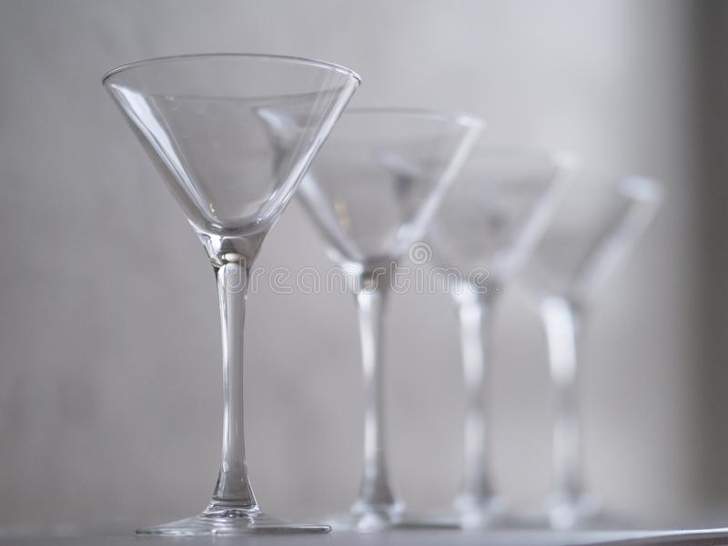 Empty wine glasses on the window sill royalty free stock image