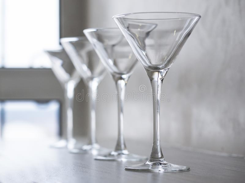 Empty wine glasses on the window sill royalty free stock photography