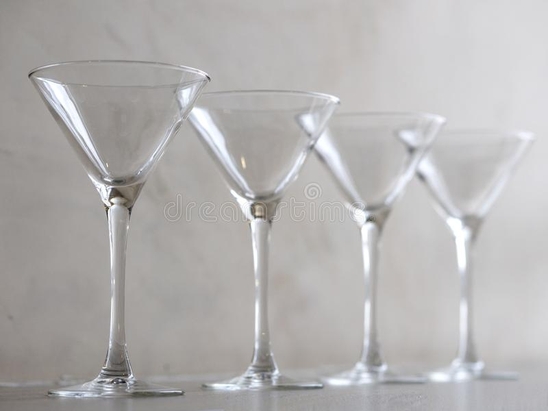 Empty wine glasses on the window sill royalty free stock photo