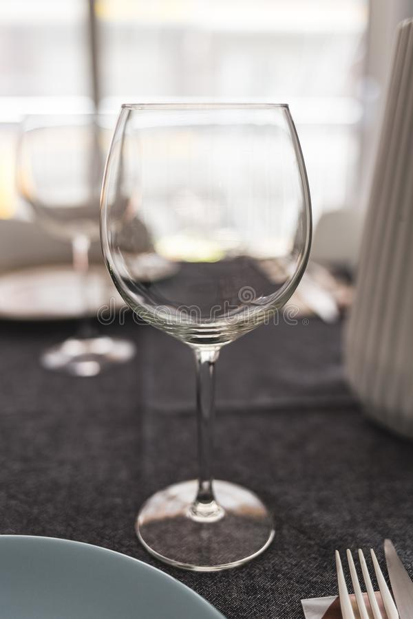Empty wineglass on a served meal table stock photography