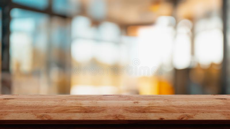 Empty wodd table with abstract modern living room style interior background royalty free stock photography
