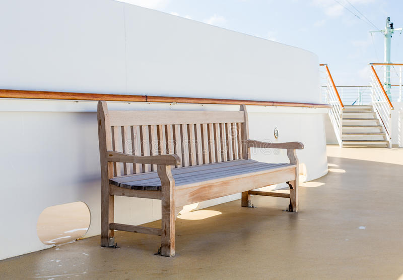 Empty Wood Bench on Cruise Ship royalty free stock photo