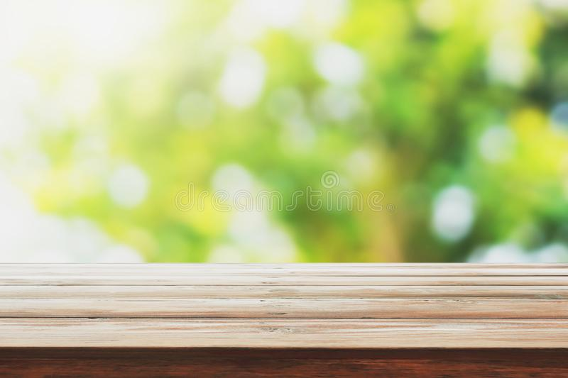 empty wood on blur green nature background for montage design product royalty free stock image