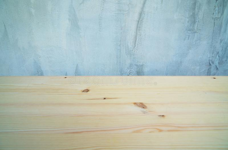 Empty wood desk and wall gray background . Blank space for text and images.  stock image