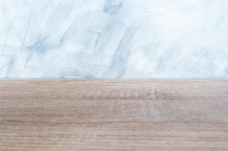 Empty wood desk and wall gray background . Blank space for text and images.  royalty free stock image