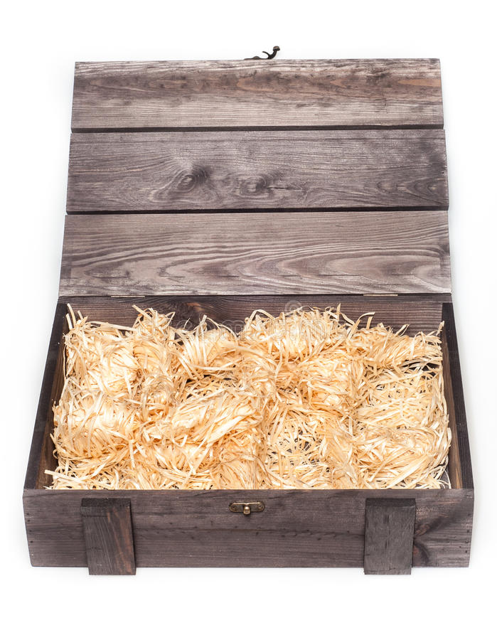 Empty wood gift box with straw stock images