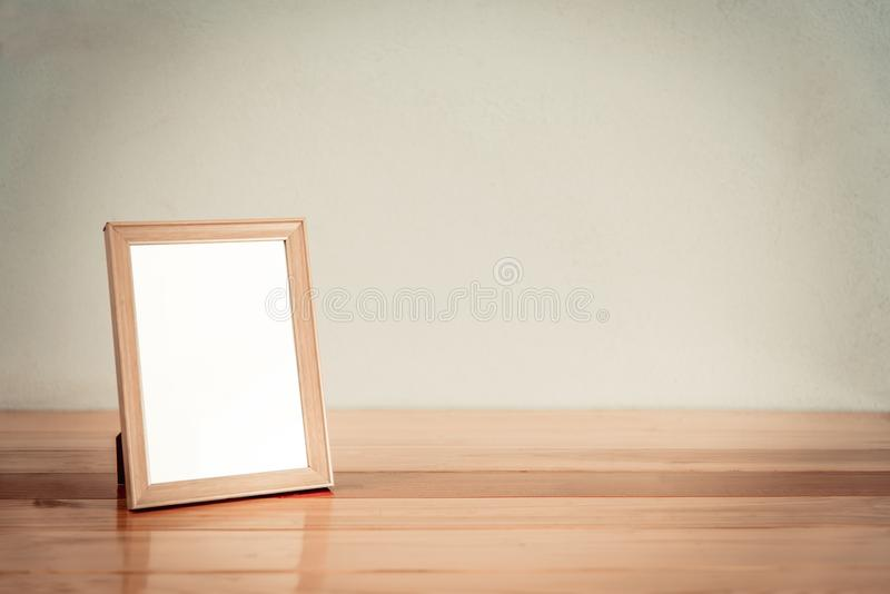 Empty wood photo frame on wooden table with copy space, picture stock photo