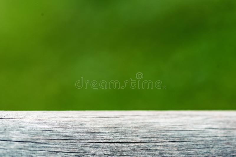Empty wood plank with blur green nature background bokeh light, Banner or header for advertise on social media stock photo