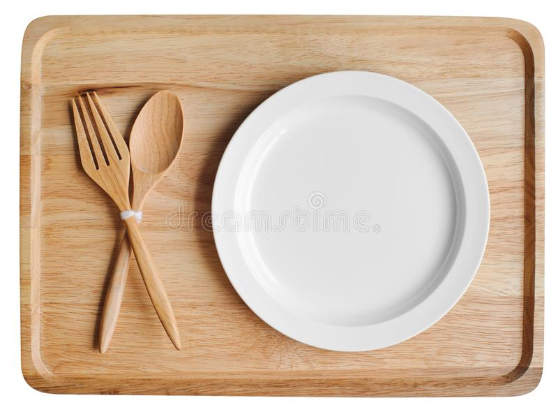 Empty wood plate dish and spoon ,fork royalty free stock photo