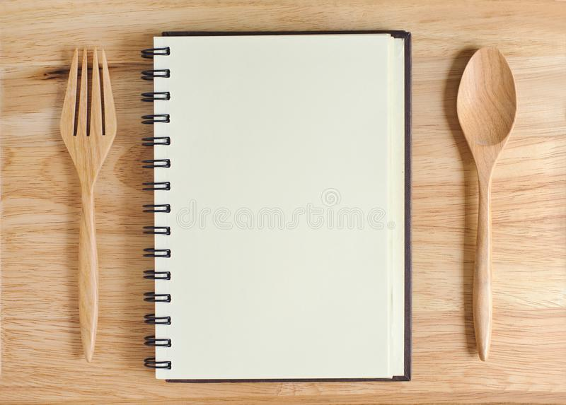 Empty wood plate with notebook isolate open and spoon fork. Empty wood plate with notebook open and spoon ,frok stock images