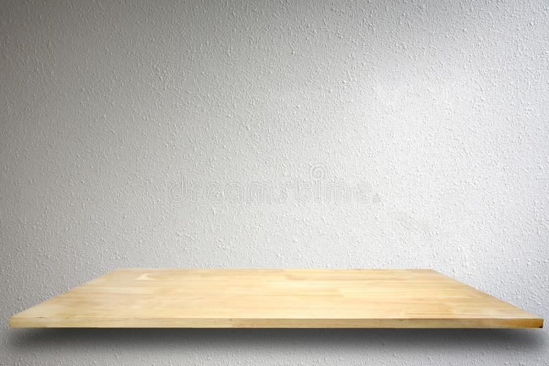 Empty wood shelf on cement wall background. Empty wood shelf on cement wall background,for product display stock images