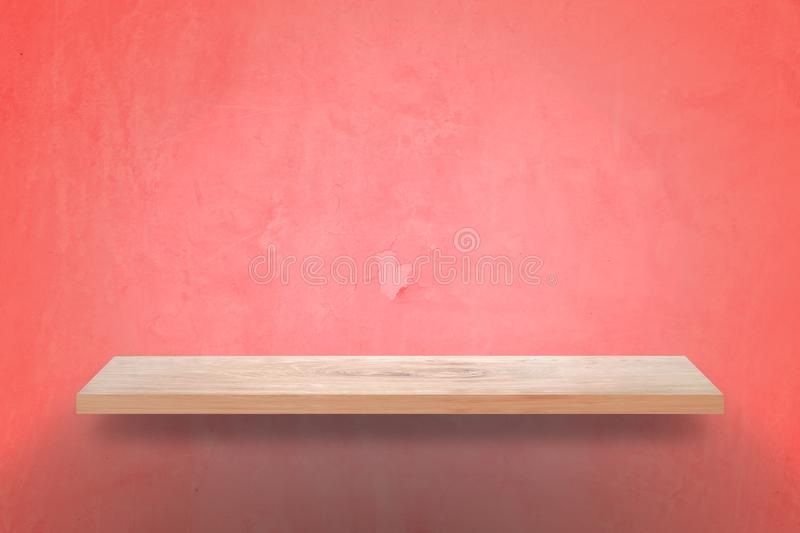 Empty wood shelf with grunge pink wall background royalty free stock photo