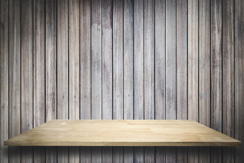 Empty wood shelf on old wood wall background. Empty wood shelf on old wood wall background,for product display royalty free stock image