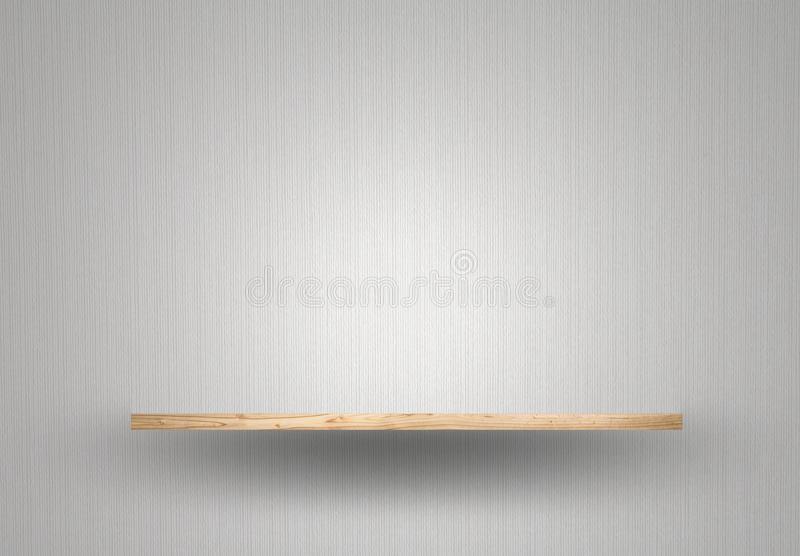 Empty wood shelf on wall. Empty wood shelf on gray wall stock photo