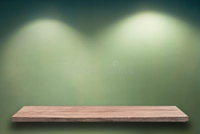 Empty wood shelf on wall. Empty wood shelf on green wall stock photography