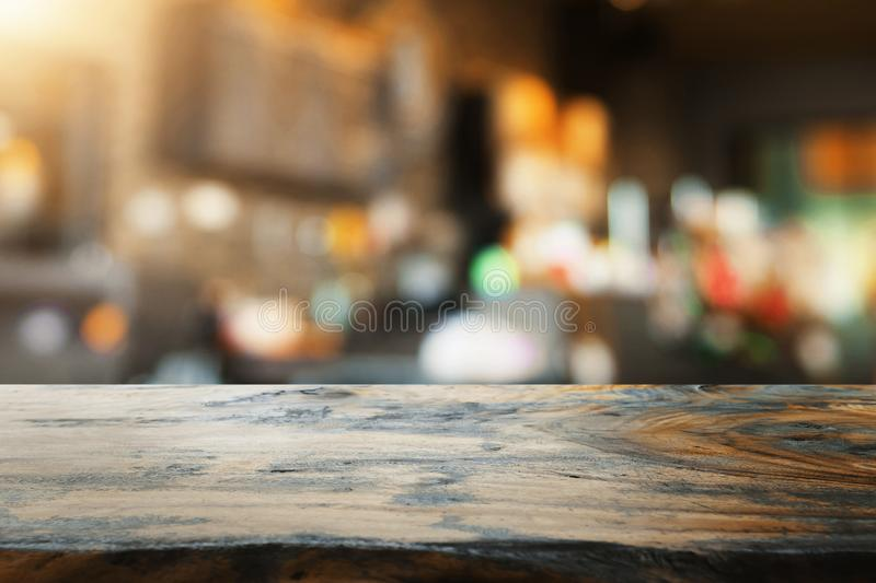 empty wood table and blur coffee shop royalty free stock image