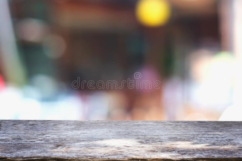 empty wood table and blur coffee shop stock photo