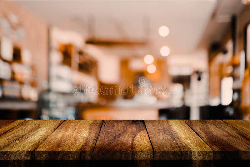 Empty wood table with blur interior coffee shop or cafe for background. Empty top of wood table with blur interior coffee shop or cafe for background stock photos