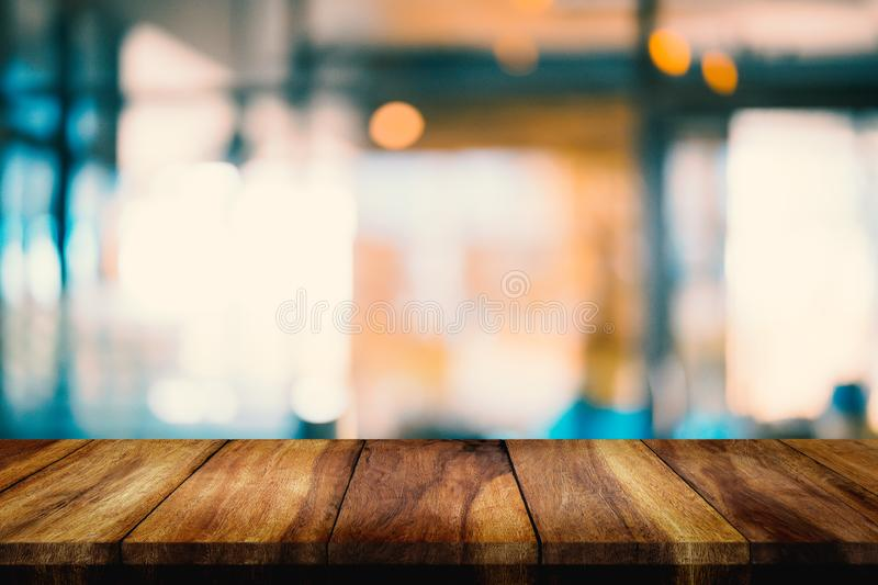 Empty wood table with blur interior coffee shop or cafe for background. Empty top of wood table with blur interior coffee shop or cafe for background royalty free stock photo