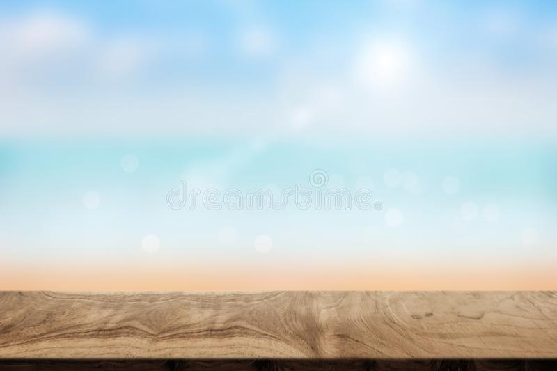 Empty wood table with blurred beach in summer. Empty top of wood table with blurred beach in summer stock image
