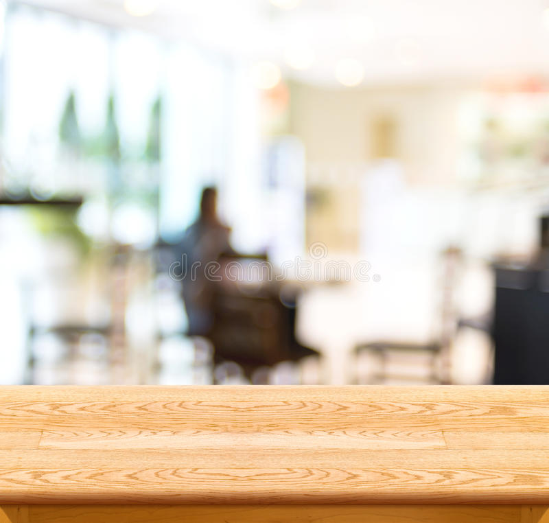 Empty wood table and blurred cafe light background. product display template.Business presentation.  royalty free stock photography