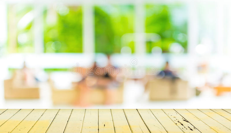 Empty wood table and blurred living room background. stock photos