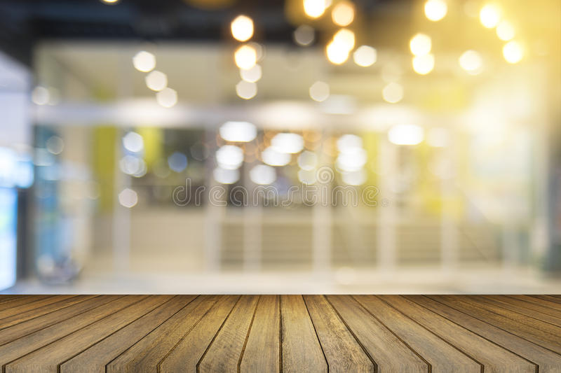 Empty wood table and blurred shopping mall in background. product display template. Business presentation.  stock images