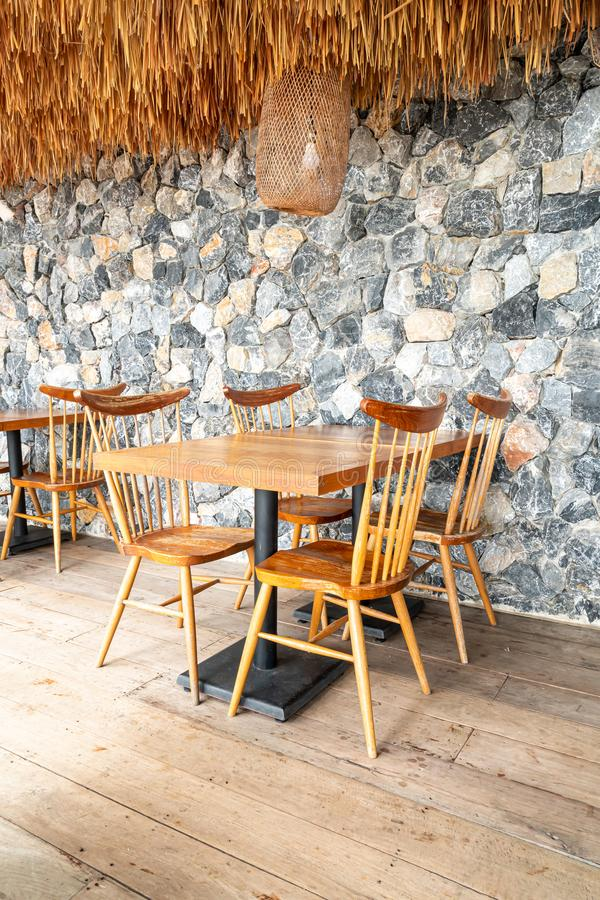 wood table and chair in cafe restaurant royalty free stock photos