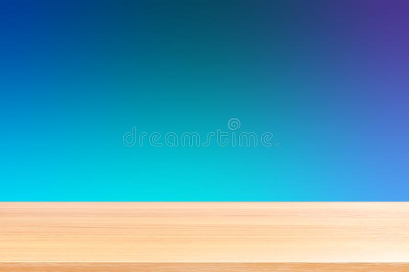 Empty wood table floors on gradient blue soft background, wood table board empty front colorful gradient, wooden plank blank stock photography