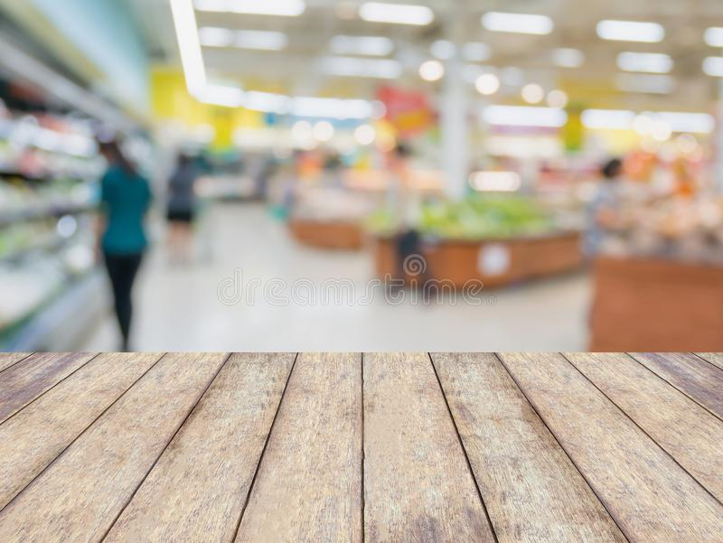 Empty wood table with grocery store background royalty free stock photos