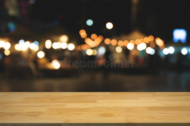 Empty wood table with night street market background.  stock photos