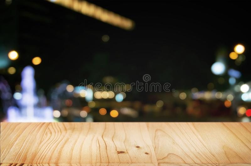 Empty wood table with night street market background.  royalty free stock image