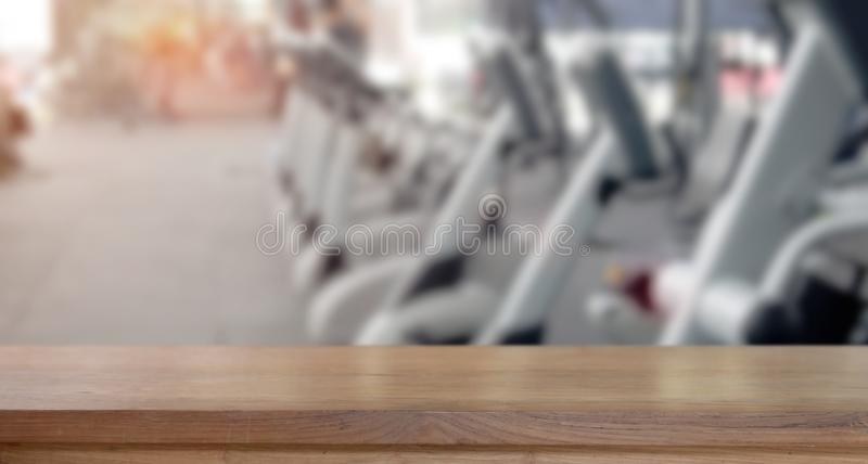 Empty wood table space in fitness gym royalty free stock photos