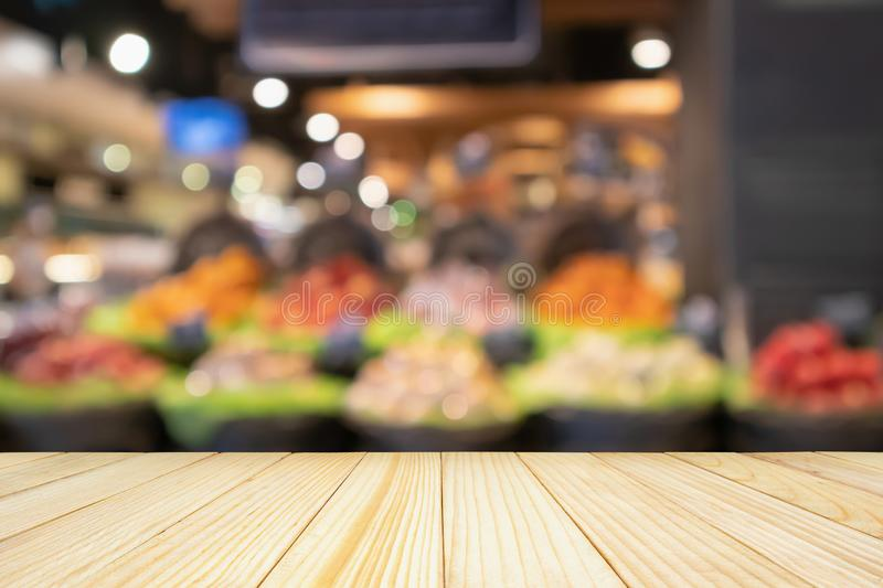 Empty wood table top with Supermarket background royalty free stock photo