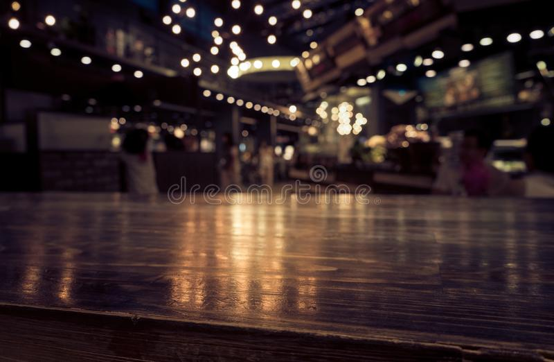 Download Empty Wood Table Top Bar On Blur Cafe Restaurant In Dark  Background Stock Photo