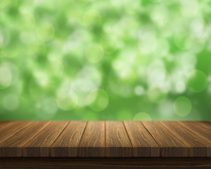 Empty of wood table top on blur of fresh green abstract from garden backgrounds.For montage product display or key stock image