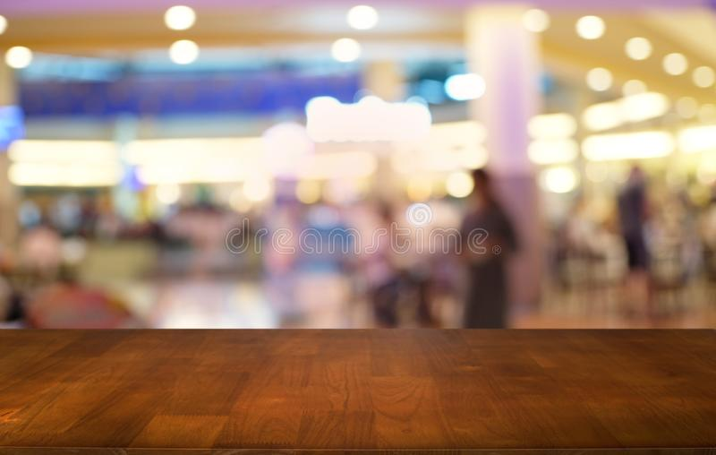 Empty wood table top and blur of night market background/selective focus .For montage product display. Empty wood table top and blur of night market background/ royalty free stock images