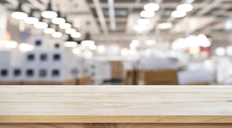 Empty of wood table top on blur store factory background. royalty free stock photos