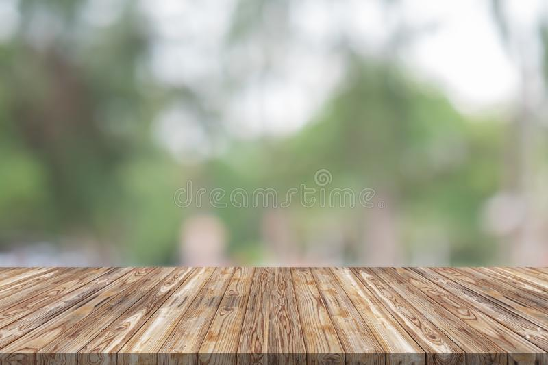 Empty wood table top on green blur background at garden royalty free stock photo