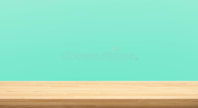 Empty of wood table top on green pastel color background.For montage product display or design key visual. Layout royalty free stock image