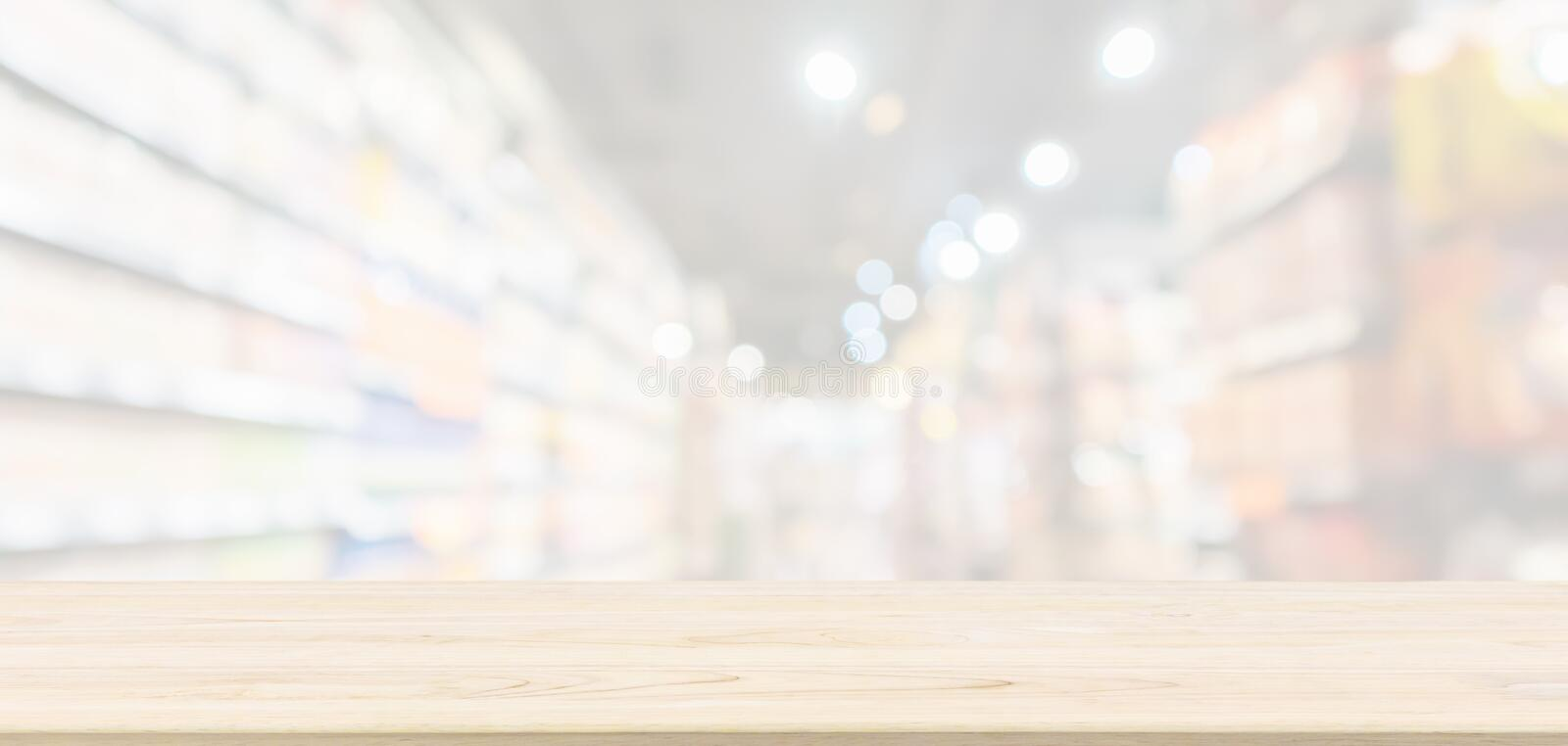 Empty Wood table top with supermarket grocery store blurred defocused background royalty free stock photos