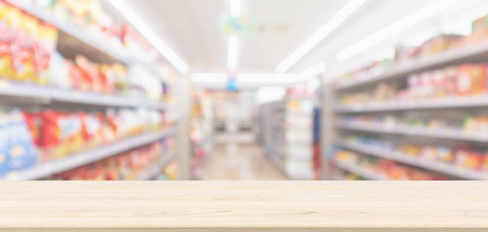 Empty Wood table top with supermarket grocery store blurred defocused background royalty free stock photo