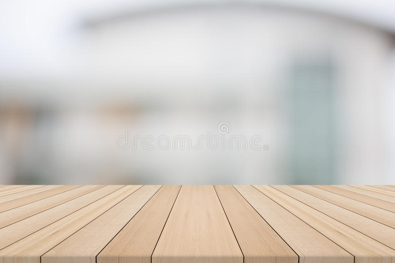 Empty wood table top on white blurred background from building. Wood table top on white blurred background from building,for montage your products royalty free stock photo