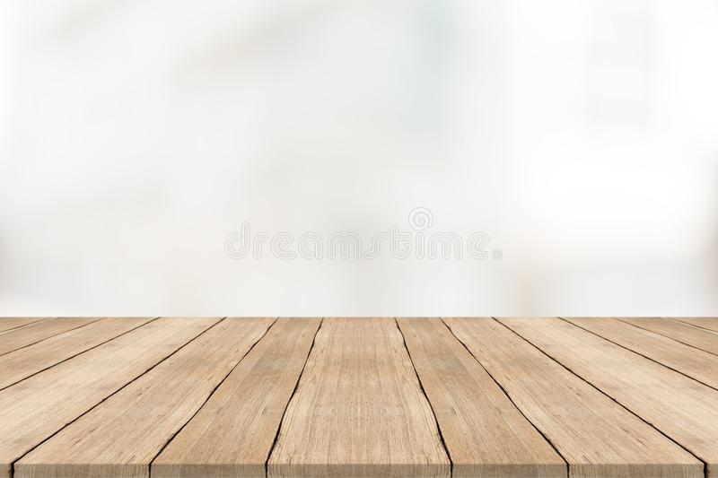 Empty wood table top on white blurred background stock photography