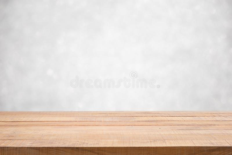 Empty wood table top on white bokeh abstract background. royalty free stock image