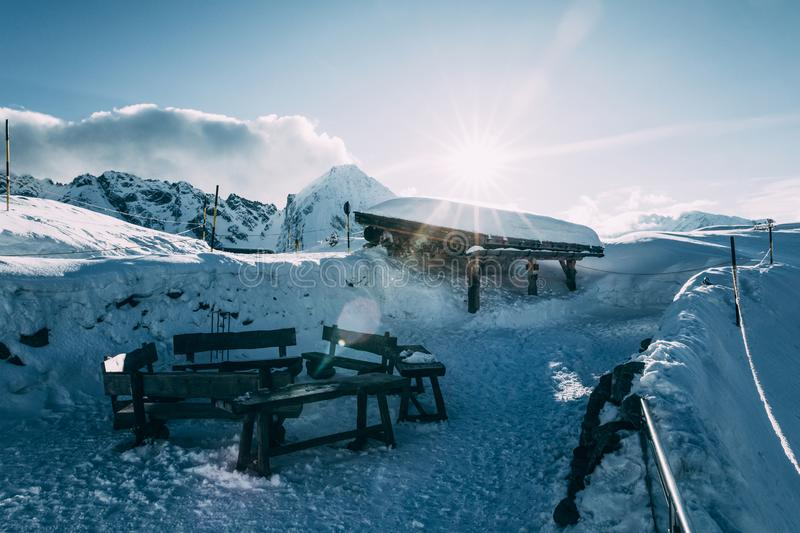 Empty wooden benches in snow-covered mountains, mayrhofen ski. Area, austria stock images